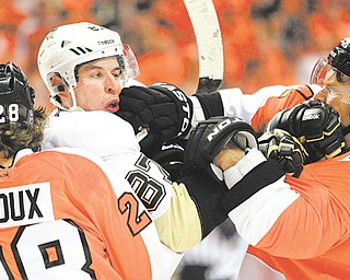 The Philadelphia Flyers' Claude Giroux holds on to the Pittsburgh Penguins' Sidney Crosby as Crosby and teammate Kimmo Timonen square off during the first period of Game 3 of the NHL Stanley Cup Eastern Conference quarterfinals at Wells Fargo Center in Philadelphia. More fists were flying than shots on goal during the fight-fraught afternoon, which ended with the Flyers pummeling the Penguins on the scoreboard, 8-4, and jumping out to a three-game lead in the series.