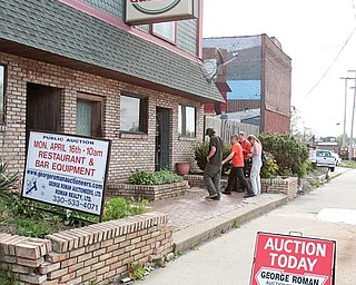 Those entering the Avalon Gardens auction stand outside as the sale progresses inside the former tavern and restaurant on Belmont Avenue. The contents of the North Side landmark were sold Monday.