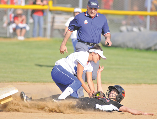 Poland's Kalie Benson puts the tag on Canfield's Alexa Bodine, who was safe trying to reach second base during their game at Canfield High. The Bulldogs scored five runs in the top of the seventh inning to pull away for the 9-2 victory over their rivals.