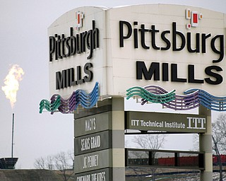 The flare from the gas burnoff from a Marcellus Shale well is seen over the Pittsburgh Mills mall in Tarentum, Pa. The flaring is a controlled burn to release pressure and test the volume of gas inside a well, according to drilling company Range Resources.