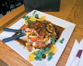 The Plaza Azteca restaurant in Niles features upscale Mexican cuisine such as this Salmon Pasilla dish, which includes a pan roasted Salmon filet, grilled vegetables, garlic mashed potatoes and a honey Pasilla sauce.
