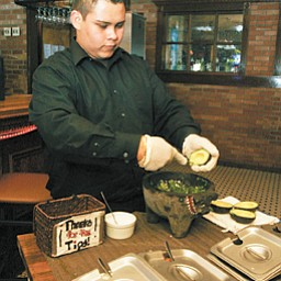 Employee Trino Ortega makes fresh guacamole. Customers can choose how much of which ingredients to make the guacamole suit their preferences in flavor and spiciness.