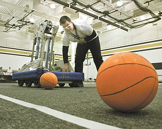 Kenny Crawford, a senior at Warren G. Harding High School, is a member of the robotics team there. The team Delphi ELITE won the chairman's award at its competition in Pittsburgh last month and will compete in St. Louis next week.