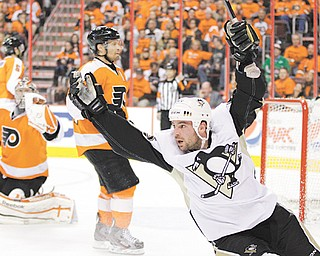The Pittsburgh Penguins' Steve Sullivan celebrates after scoring a goal against the Philadelphia Flyers' Kimmo
