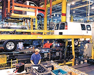 General Motors employees work on a van assembly line at GM's plant in Wentzville, Mo. The U.S. auto industry, already stretched to meet growing car and truck sales, faces parts shortages that could limit the number of new vehicles in showrooms later this year and crimp a historic turnaround.