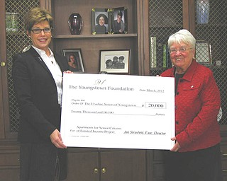 The Youngstown Foundation has awarded the Ursuline Sisters of Youngstown's Apartments for Senior Citizens of Limited Income Project a grant of $20,000. Jan Strasfeld, left, executive director of the foundation, recently presented a ceremonial check to Sister Nancy Dawson, right, general superior of the Ursuline Sisters. In May, the Sisters will begin construction in consonance with Universal Design principles on 12 barrier-free apartments in the west wing of their Motherhouse in Canfield, a project that will cost approximately $1.2 million. In addition to gaining safe and affordable housing, area seniors of more moderate income will benefit from socialization and having access to numerous programs offered at The Ursuline Center and Motherhouse. The Youngstown Foundation is the eighth-largest community foundation in Ohio and ranks among the top 10 percent in the country.