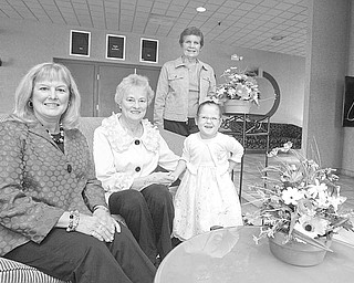 Robert K Yosay | The Vindicator: Chairwomen of the Angels of Easter Seals Spring Luncheon & Style Show, planned for May 10 at Mr. Anthony's in Boardman, are, left to right, Lynn Sahli, Sally Reedy and Jane Evans. Little Lily DeMarco, 5, is an Easter Seals client.