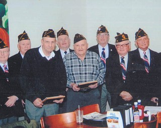 Three members of Boardman Memorial American Legion Post 565 recently received 50-year membership awards at a meeting that took place at the Golden Corral Restaurant in Boardman. Recipients were Angelo Cercone, Tom Kurochak and Peter Vitko. Milo Sincich of Seabrook, Texas, was unable to attend the event, but was recognized as a 60-year member. Shown are award recipients and post officers, from left, back row, Steve Janis, adjutant; Ted Vestal, sgt. of arms; Tom LaPaze, financial officer; Ed Onderko, second vice commander; and John Molson, chaplain. In the front row are Cercone; Vitko, J.E. Malys, commander; and Kurochak.