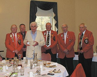 Ted Cubbison, third from left, a member of the Youngstown Lions Club, recently received one of the highest awards in Lionism for his outstanding work and dedication to the club. The prestigious past district governor's award is given to very few people, and five past district governors attended the local group's weekly meeting at Park Vista Retirement Center in Youngstown to present the award. They are, from left, Harold Ullman, Ron Clifton, Bob Whitehead, Don Martin and Ted Filmer. Cubbison is a resident at the retirement center.