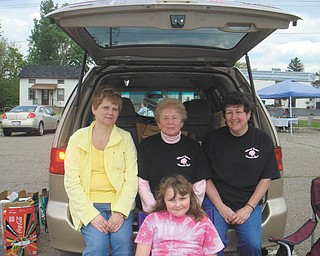 Girard Junior Women will sponsor a trunk sale from 10 a.m. to 2 p.m. May 12 in the Girard City parking lot, across the street from the Girard City Hall/Justice Center. Preparing for the sale are, from left, Kathy Rossell, Martha Altiere and Laura Sobnosky (and her daughter.) The public is invited to buy or sell items, and spaces to set up a table or sell directly from a car trunk are $10. There also will be a special sale table of items donated by the group. All proceeds will benefit the Girard community. For table reservations call 330-545-5962.