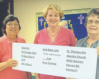 The Women's Altar and Rosary Guild of St. Thomas the Apostle Church (formerly St. Vincent de Paul), 4453 Warren-Sharon Road, Vienna, will sponsor its annual rummage sale from 10 a.m. to 4 p.m. May 4 and from 9 a.m. to 2 p.m. May 5. Holding a banner listing the details are, from left, Florence Gordon, treasurer; Pat Slavin, project chairwoman and secretary; and Dianne Setterberg, guild co-president. The sale will include household and kitchen items, linens, crafts, children's clothes, small furniture, jewelry, books and more. There will be free admission and parking, and Saturday will be half-price day.