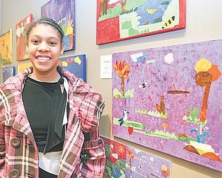 """Chaney sixth-grader Beunita Jones stands by several images she helped create for the book """"A Walk In the Garden"""" based on experiences of 40 students who spent time in Mill Creek Park."""