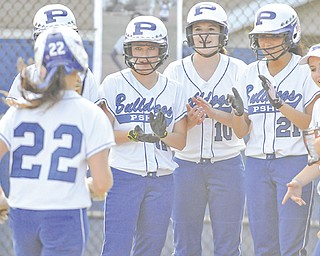 Poland's Erin Gabriel is greeted by teammates, including Marissa Trevis (12), Arlia Duarte (10) and Kalie Benson (21), as she heads home after hitting a grand slam in the fourth inning of Wednesday's softball game against Howland in Poland. As the starting pitcher, Gabriel posted 13 strikeouts and allowed only two hits in the Bulldogs' 17-2 win over the Tigers.