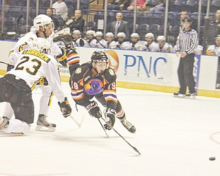 The Youngstown Phantoms' Dylan Margonari (19) is tripped up by the Green Bay Gamblers' Markus Lauridsen (23) during the fi rst period of Game 4 of Eastern Conference semifi nals of the USHL's Clark Cup playoffs Wednesday at the Covelli Centre. The Phantoms led 1-0 after two periods, but the Gamblers rallied to win 4-1, bringing Youngstown's season to an end.