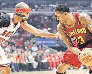 Chicago Bulls guard Richard Hamilton (32) guards Cleveland Cavaliers forward Alonzo Gee (33) during the fi rst half of Thursday's NBA game in Chicago. The Cavs fell 107-75.