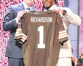 Alabama running back Trent Richardson poses with NFL Commissioner Roger Goodell after being selected as the third pick overall by the Cleveland Browns on Thursday in the first round of the 2012 NFL Draft at Radio City Music Hall in New York. About a half hour before the draft began Cleveland traded its fourth-, fifth- and seventh-round choices with Minnesota to move up from the No. 4 spot to No. 3 and secure Richardson.