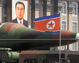 What appears to be a new missile is carried during a mass military parade at Kim Il Sung Square in Pyongyang, North Korea, to celebrate the 100th anniversary of the country's founding father, Kim Il Sung. Analysts say the half-dozen missiles showcased at the military parade were low-quality fakes.