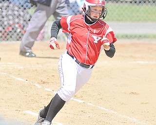 Youngstown State senior Haley Thomas rounds first base on her way to second during the first game of a doubleheader against the University of Illinois-Chicago on Sunday at McCune Park in Canfield. The Penguins split with the Flames, dropping the first game 11-8, but winning the nightcap 9-7. Thomas went 4-for-8 on the day to tie the team's single-season hits record of 64 set by Amanda Berry in 2003.