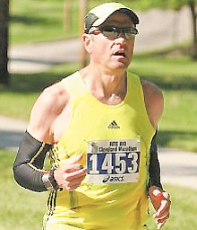 Facing a health crisis, Ken Smith went on a strict weight-loss regimen and was inspired to start a regular schedule of full- and half-marathons.