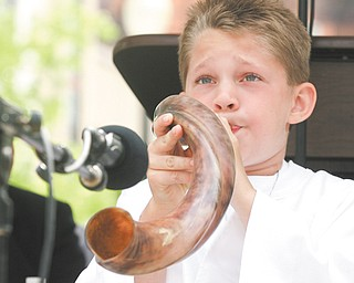 Elijah Maybou, 9, of Warren blows a shofar (ram's horn) to begin the noon National Day of Prayer observance in downtown Youngstown. The event, sponsored by the City Prayer Team of Youngstown, featured Pastor Everett Whiteside as keynote speaker.