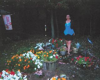 Standing amid a multitude of blooms is Deborah Carissimi of Boardman.