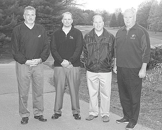Photo by Nick Mays   The Vindicator:  From left, Joe Valvo, Mark Shaw, Dana Balash and Dr. Mike Burley prepare for the American Heart Association Golf Scramble, set for June 6 at the Youngstown Country Club.