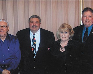 Trumbull Township Association recently met to reorganize and install officers for 2012. Officers are chosen to represent elected township officials in Trumbull County and to promote grassroots government at state and local levels as part of the greater Ohio Township Association. Elected were, from left, Fred Bobovnyk, Ohio Township Association state committeeman (Weathersfield Twp.); Mark S. Finamore, president (Vienna Twp.); Rebecca Whitman, secretary/treasurer (Hartford Twp.); and Clifford S. Plott, vice-president (Southington Twp.).