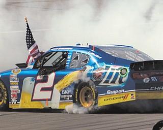 Brad Keselowski performs a burnout after winning a NASCAR Sprint Cup Series race at Talladega Superspeedway in Talladega, Ala., on Sunday.