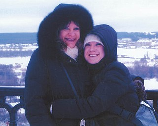 """Sarah Emerick of Hudson, Ohio, said that since 1999, her mother, Kathryn Adams of Canfield, has been leading """"Volunteer in Missions"""" teams to work with underprivileged orphans. This photo, taken in Vladimir, Russia, is from such a trip when Sarah accompanied her mother. She said she's always been so proud of her mom and her humanitarian work."""