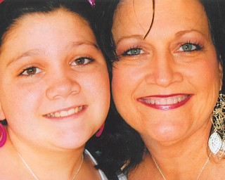"""Julie Carino, 10, wrote this about her mom, Gayle Carino: """"With me and my mom we don't have a favorite memory. We make new ones every day. So manny I've lost count. Theres just not enough word to describe her. Like beautiful she gives it a whole new meaning. I love my mom without explanation."""" They live in Austintown."""