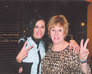"""At her mother's 70th birthday party, Angela Ritz of Boardman and her mother, Katie Balale of Campbell, flash a """"peace out"""" gesture. Angela said this about her mother's battle with breast cancer: """"Cancer didn't change my mother, it just proved to me what a warrior she really is."""""""