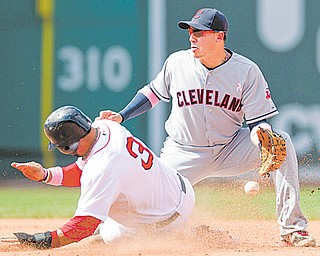 Boston Red Sox's Mike Aviles, left, steals second base as Cleveland Indians shortstop Asdrubal Cabrera is unable to get his glove on the ball in the sixth inning of a baseball game at Fenway Park in Boston on Sunday.