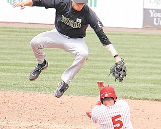 Youngstown State base-runner Marcus Heath (5) slides under Wright State infielder Justin Kopale during Sunday's game at Eastwood Field.