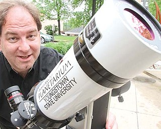 YSU Astronomy professor Dr. Patrick Durrell shows a telescope that will be used for viewing the June 5 transit of Venus.