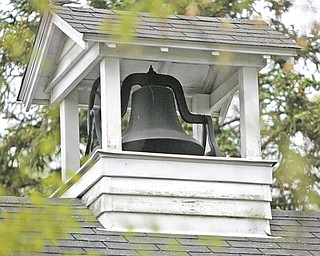 The original school bell still works and sits atop the brick building.
