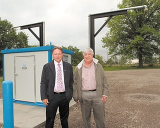 Struthers Mayor Terry Stocker, left, and Al Sauline, area manager for Aqua Ohio, show off Aqua Ohio's new pump station that will serve trucks getting water for delivery to hydraulic-fracturing sites in Ohio.