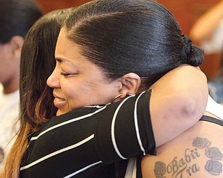Tracee Hewlett, right, mother of slain teen Tracee Banks, gets a hug from Cierra Smith after guilty verdicts are read in the case of Melvin Shaw II. He was found guilty Tuesday of killing Banks in 2010.