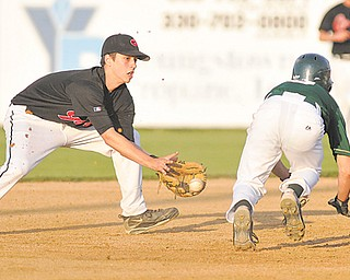 Girard shortstop Nick Cavalier attempts to pick off Ursuline's Joel Hake. Hake was out on the play, but the Irish beat the Indians in the Division III district final, 3-2, in extra innings.
