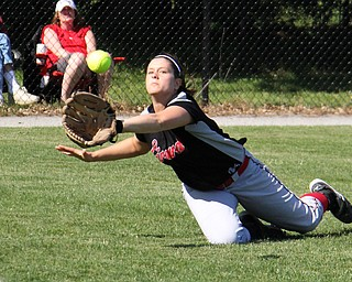 Girard senior outfielder Morgan Walters dives for a catch in right field during Thursdays district championship game at South Range High School in Canfield. Dustin Livesay     The Vindicator