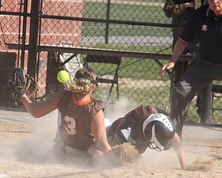 East Palestine pitcher Karly Pence (3,left) gets tripped up by the slide of Girard baserunner Bryanna Jay (20) during Thursdays district championship game at South Range High School in Canfield. Dustin Livesay     The Vindicator