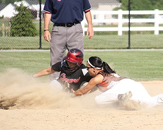 East Palistine's Carly Blair (8,right) reaches to tag out Mickey Sigurani (21) of Girard during Thursdays district championship game at South Range High School in Canfield. Dustin Livesay     The Vindicator