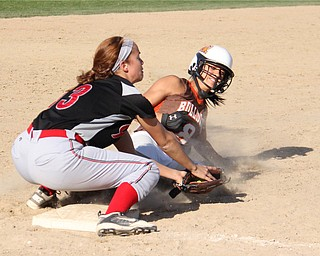East Palestines Carly Blair (8,right) slides into third base underneath the tag by Girard's Alli Rose (13,left) during Thursdays district championship game at South Range High School in Canfield. Dustin Livesay  |  The Vindicator