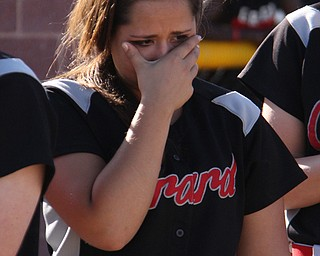 Mickey Sigurani of Girard wipes tears from her eyes after her team lost Thursdays district championship game against East Palestine at South Range High School in Canfield. Dustin Livesay  |  The Vindicator