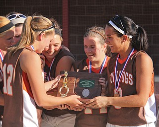 East Palestine players including (front right to left) Carly Blair (8,far right), Logan Gatchel (11,second from right) and Paige Patterson (12,far left) celebrate after getting the championship trophy for beating Girard during Thursdays district championship game at South Range High School in Canfield. Dustin Livesay  |  The Vindicator