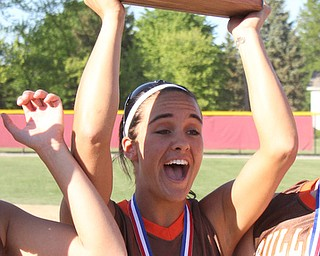 East Palestine senior Carly Blair (8) raises the district Championship trophy to the crows after her team beat Girard in Thursdays district championship game at South Range High School in Canfield. Dustin Livesay     The Vindicator