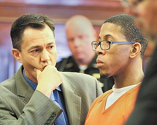 Randal Brown, right, faces sentencing with his attorney, Ronald Yarwood, in the courtroom of Judge R. Scott Krichbaum of Mahoning County Common Pleas Court. The judge sentenced Brown to three years in prison Thursday for having unprotected sex with a woman while knowing he was HIV-positive.