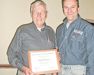 Ralph Witmer, left, of Columbiana, was recently presented with a certificate of recognition by Steve Knizat, vice president of the Columbiana County Fairboard. Every year, individuals from across the state are recognized for their outstanding support of local fairs during ceremonies at the Ohio Fairs convention in Columbus. Witmer represented the Columbiana Fair with this honor and was thanked by the board for his continued devotion and support of the fair through the years.