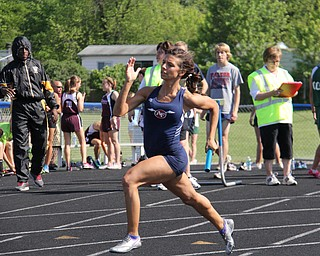 Jenna Yacovone of Austintown Fitch runs her leg of the 4x200 meter relay during Fridays Division one district championship track meet at Austintown Fitch High School. Dustin Livesay  |  The Vindicator