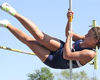 Junior Kayla Baily of Austintown Fitch kicks her legs up and over the pole vault pole during Fridays Division one district championship track meet at Austintown Fitch High School.  Dustin Livesay  |  The Vindicator
