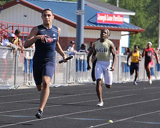 Nathan Bowlen of Fitch leads his 4x200 meter relay team to first place during Fridays Division one district championship track meet at Austintown Fitch High School. Dustin Livesay  |  The Vindicator